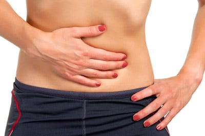 woman suffering from stomach bloating pain in San Antonio TX
