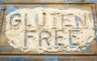 gluten free written in wheat flour on a board
