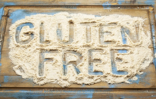 gluten free written in wheat flour on a board