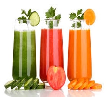 pressed juice in 3 glasses with vegetables