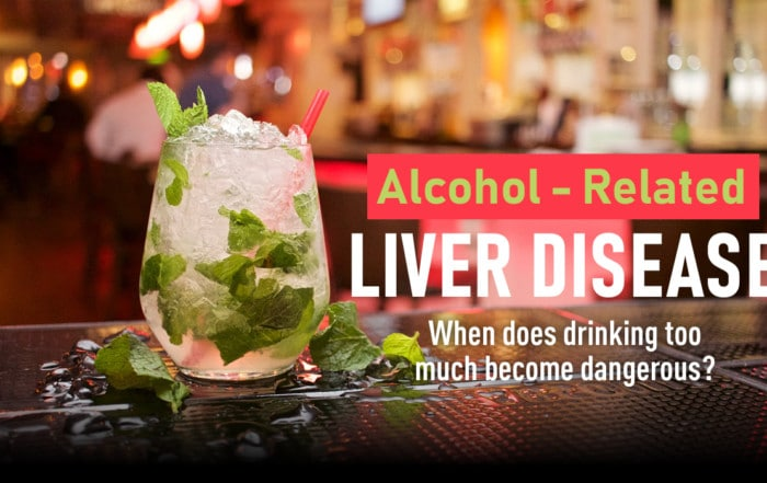 alcoholic liver disease text next to a cocktail on a bar